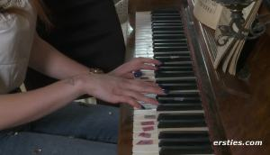 Piano Teacher Hits The Right Notes.